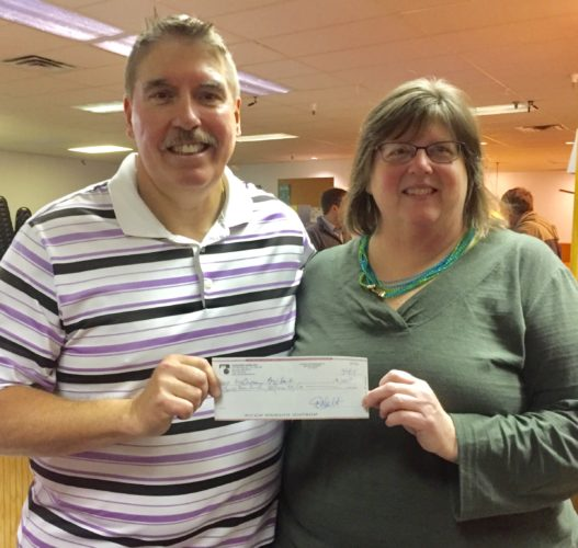 Submitted photo Executive Director of McCrossan Boys Ranch accepts a $200 check from Mona Albrecht of Concordia Lanes.