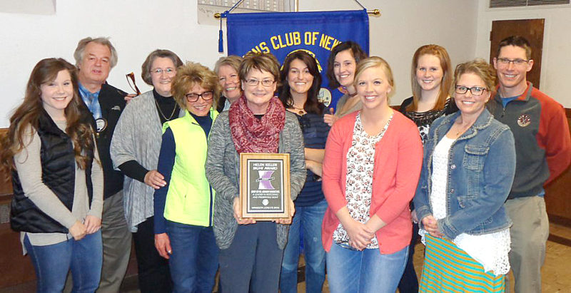 """The Lions Club of New Ulm presented the """"Helen Keller Sight Award"""" to the staff of Lion Kenneth Windschitl DDS at their April 11th meeting. For 34 years the staff has collected used eye glasses that are sorted and distributed to needy people in third world countries who have little or no eye care available to them. The staff estimates that they have helped collect and sort hundreds of thousands of used eyeglasses in the past 34 years. The public is invited to donate their used eyeglasses to collection boxes that are available at local banks and other places in New Ulm. The staff is pictured from L-R, Katlyn Tessmer, Dr. Windschitl, Karon Metz, Julie Schugel, Mary Windschitl, Nancy Haala, Natalie Helget, Kayla Weinkauf, Carly Jensen, Elizabeth Fischer, Chris Iles and Dr. John Brownfield."""