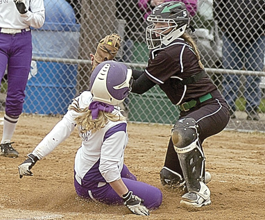 Staff photo by Steve Muscatello New Ulm's Carli Botten slides into home before Pipestone Area catcher Logan Winter can tag her Thursday at Harman Park in New Ulm. For more photos of this event go to cu.nujournal.com