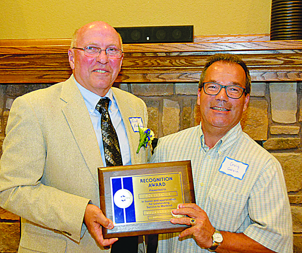 Submitted photo  Sertoma Club President Craig Galvin (right) presents the Service to Mankind award for 2017 to Dick Embacher. Embacher was recognized for his dedication to the community, organizations, neighbors and the surrounding area.
