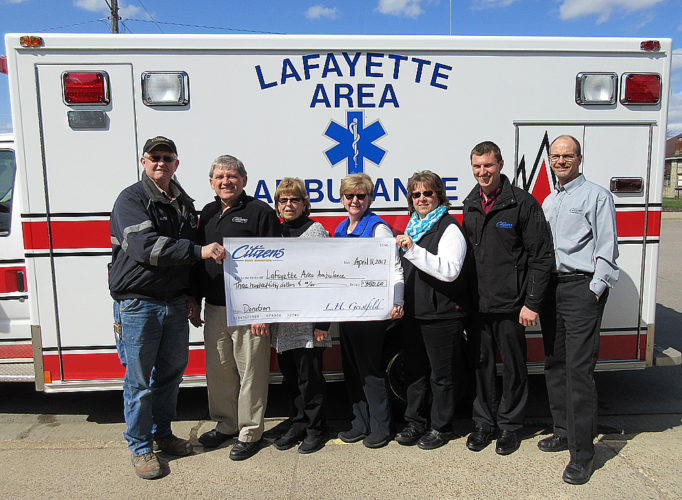 """Submitted photo  Citizens Bank Minnesota 'Jeans for Change' recently donated $350 to the Lafayette Area Ambulance. Jeans for Change was started in March of 2017 with the idea that all bank employees can donate $5 to wear jeans on the first Friday of each month. The proceeds are then given to area non-profits. In April the money raised went towards the Stryker hydraulic-powered ambulance cot. Mark Dick, President of the Lafayette Area Ambulance, stated """"The cot can support 650 pounds and be loaded by one person into the back of the ambulance."""" Pictured from left to right: Mark Dick, President of the Lafayette Area Ambulance, Kevin Yager, Sheri Portner, Lori Dick, Laura Isaacson, Nick Peterson and Robert Wise of Citizens Bank Minnesota, Lafayette Branch."""