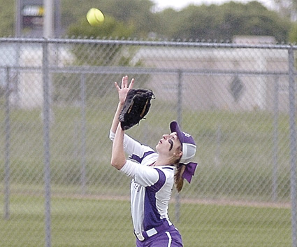 Staff photo by Steve Muscatello New Ulm left fielder Teresa Ahlers looks the ball into her glove for a catch during the Eagles' playoff loss to Mankato West on Thursday at Caswell Park in North Mankato. For more photos of this event go to cu.nujournal.com