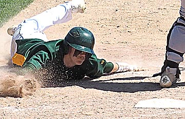 Photo courtesy of Mary Woitas Sleepy Eye St. Mary's Nick Labat slides home safely during the big seven-run sixth inning in Friday's Section 2A baseball playoff win against Mountain Lake Area-Comfrey.