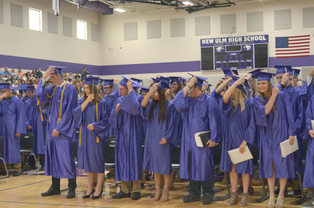 Staff photo by Connor Cummiskey The 2017 graduating class of New Ulm Public Schools moves their tassels from the right to left sides of their caps. This class was the first to graduate from the newly constructed high school. See more photos on page 12B. and on cu.nujournal.com