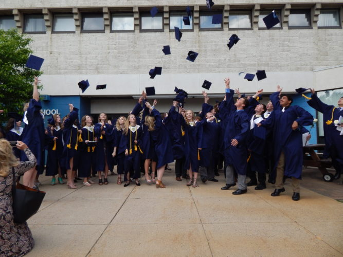 Staff photo by Fritz Busch  Minnesota Valley Lutheran High School students toss their mortarboards after the 2017 Commencement Service Sunday afternoon.