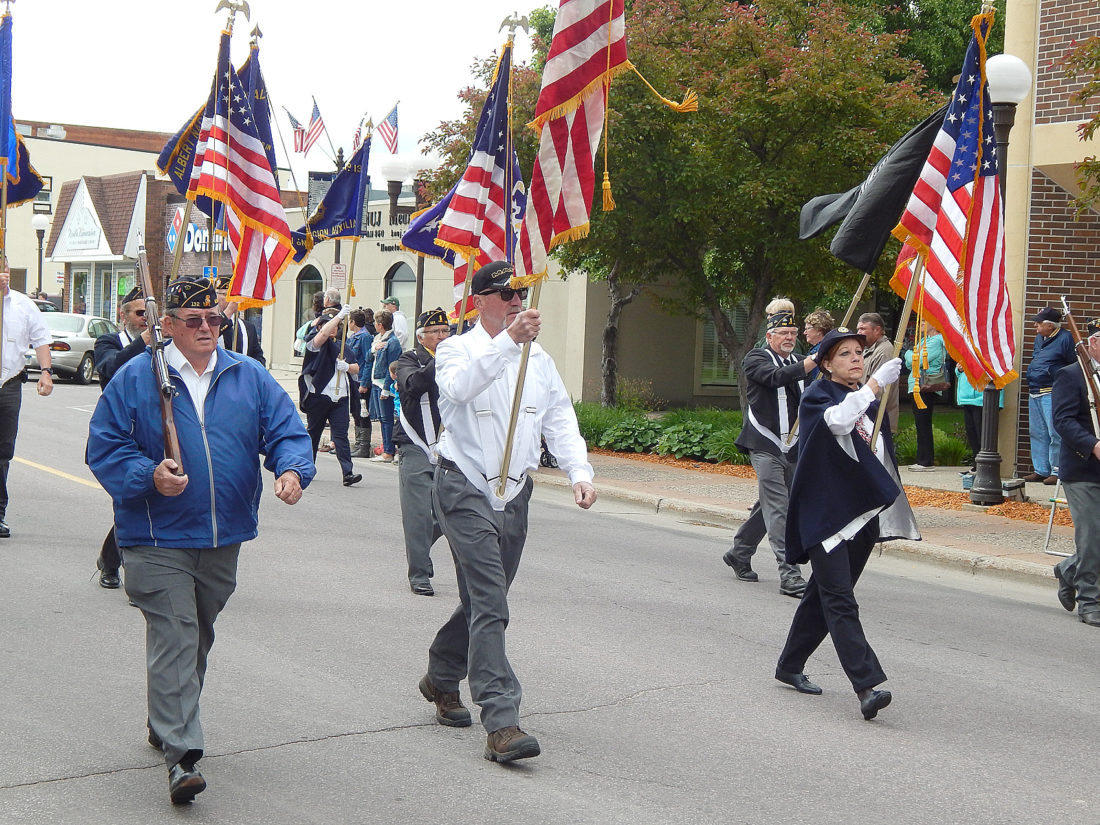 Staff photo by Fritz Busch The Veterans Color Guard marches up Minnesota Street in the Memorial Day Parade, just prior to a New Ulm City Cemetery Observance Monday.