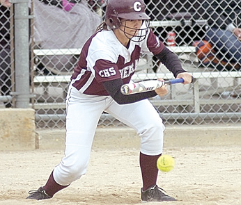 Staff photo by Steve Muscatello New Ulm Cathedral's Allison Beranek drops down a bunt during the Greyhounds' Section 2A playoff game against Mankato Loyola Tuesday at Caswell Park in North Mankato. For more photos of this event go to cu.nujournal.com