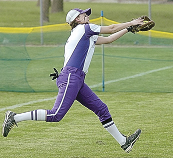 Staff photo by Steve Muscatello New Ulm's Kaila Brudelie makes a running catch in right field during the Eagles Section 2AAA playoff win against Mankato East Tuesday at Caswell Park in North Mankato. For more photos of this event go to cu.nujournal.com