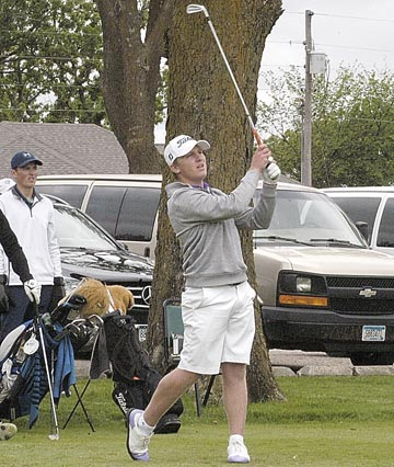 Staff photo by Jake Calhoun New Ulm's Glavine Schugel watches his shot after teeing off on the No. 10 hole at the Section 3AA golf meet on Tuesday at Oakdale Golf Course in Buffalo Lake. Schugel was the boys' meet's medalist.