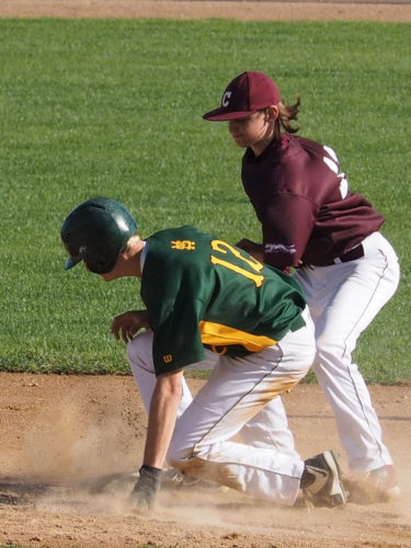 Photo courtesy of Mary Woitas Sleepy Eye St. Mary's senior Nic Helget slides into second base against New Ulm Cathedral in a Section 2A consolation baseball game on Thursday at Sleepy Eye Ballpark.