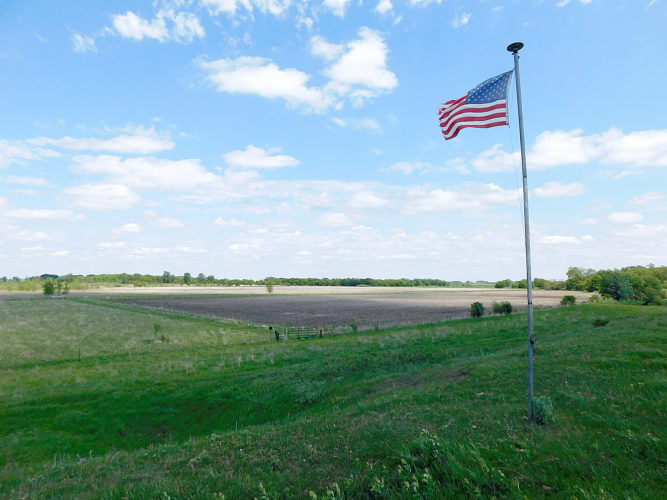 Staff photos by Clay Schuldt  The American Flag located less than a mile from Comfrey marks the spot where in February 1963 a B-47 bomber crashed, claiming the lives of four Air Force crew members.