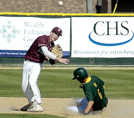 Staff photo by Steve Muscatello Springfield's Decker Scheffler makes a throw to first as Sleepy Eye St. Mary's Alex Woitas slides into second during Section 2A playoff action Tuesday at Franklin Rogers Park in Mankato. For more photos of this event go to cu.nujournal.com