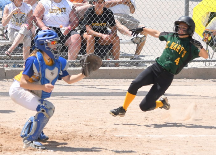 Photo courtesy of Don Borstad Sleepy Eye St. Mary's Kelsie Kosak slides home in the third-place game against Hayfield on Friday at Caswell Park. The Knights won 15-2 in five innings.