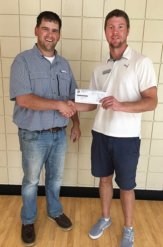 Submitted photo  Jake Meyer (left) with New Ulm Quartzite Quarries, a division of Oldcastle Materials, presents Joey Schugel of the New Ulm Park and Rec Department with a $250 dollar check to help fund the Park and Rec's Days of Play event planned for August 2017.