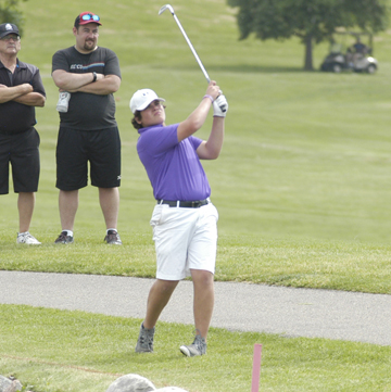 File photo by Jake Calhoun New Ulm's Aiden Guggisberg hits an approach shot at the Class AA Boys' State Golf tournament on Wednesday in Jordan.