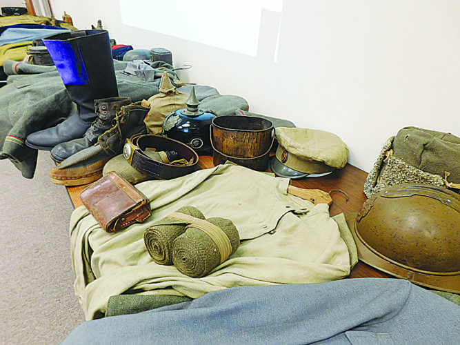 Doug Bekke, collector and former curator of the Minnesota Military Museum, brought in examples of World War I uniforms from several nations (above) and explained the background and significance of each piece, Thursday, at the Brown County Museum Annex.