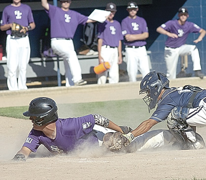Staff photo by Steve Muscatello Sleepy Eye VFW catcher John Luu Mathiowetz tags out a Sioux Falls East player as he slides into home Tuesday in Sleepy Eye. For more photos of this event go to cu.nujournal.com