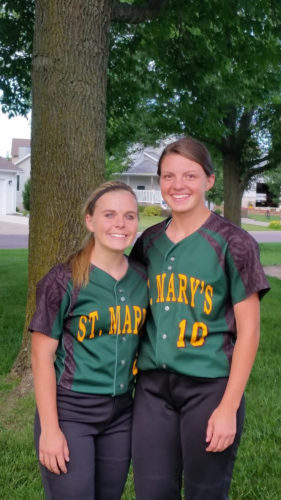 Staff photo by Jake Calhoun St. Mary's junior shortstop Jody Hansen, left, and senior pitcher Anna Lux helped lead St. Mary's to a third-place finish at state.