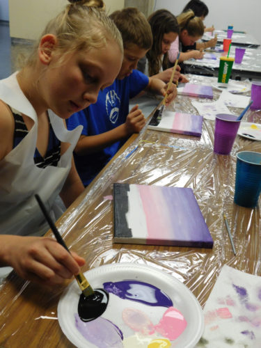 Foreground, from left, siblings Stasi, Isaiah and Zoe Scharf and other children take part in Wednesday's class.