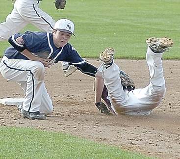 Staff photo by Steve Muscatello New Ulm VFW Silver second baseman William Schabert tags out Mankato's Nolan Michels as he slides into second during the opening game of the Junior Upper Midwest Classic Thursday at Johnson Park. For more photos of this event go to cu.nujournal.com