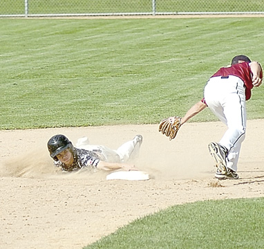 Staff photo by Steve Muscatello New Ulm VFW Silver's Cole Backer slides into second under the tag of Maple Grove second baseman Nathan Kasper during the Junior Upper Midwest Classic Friday at Johnson Park. For more photos of this event go to cu.nujournal.com