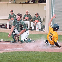 Staff photo by Steve Muscatello Sleepy Eye cacher Caleb Berg waits for the ball as New Ulm Legion Gold's AJ Lassas slides into home Monday at Mueller Park in New Ulm. For more photos of this event go to cu.nujournal.com