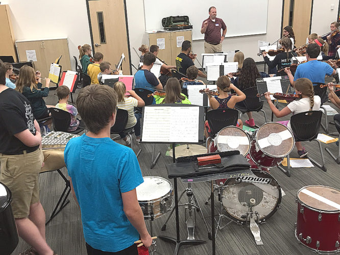 Submitted photo Students in the New Ulm Suzuki School's Pop'sCamp rehearse under director/clinician Carl Rieke. The students will be presenting a final performance this evening at 7 p.m. in the New Ulm High School auditorium.