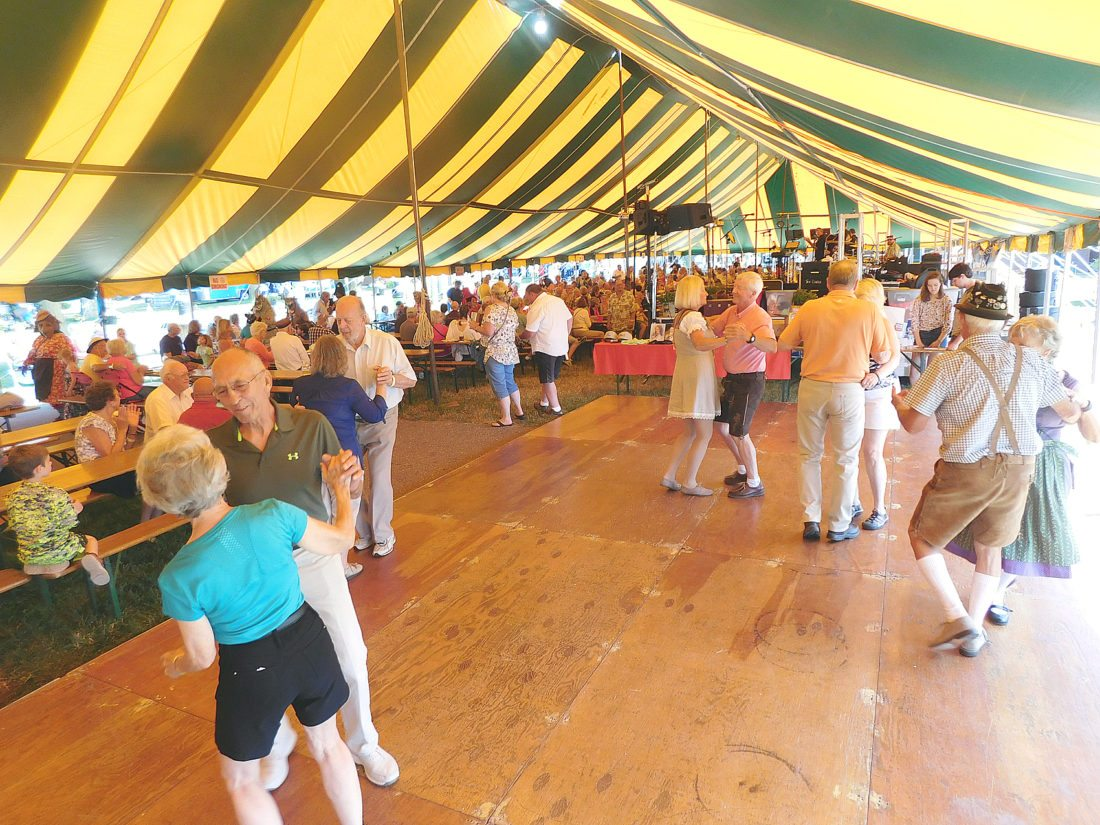 Staff photo by Clay Schuldt The dance floor under the Schells Tent was filled up quick Friday afternoon. The crowds dance to the music of the Concord Singers, Alpensterne and Squeezebox with Mollie B. See more photos on page 8A, and on The Journal's CU site, cu.nujournal.com