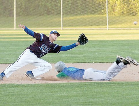 Staff photo by Steve Muscatello New Ulm Brewers second baseman Zach More waits for the ball as a Bird Island baserunner slides into second Friday at Johnson Park in New Ulm. For more photos of this event go to cu.nujournal.com