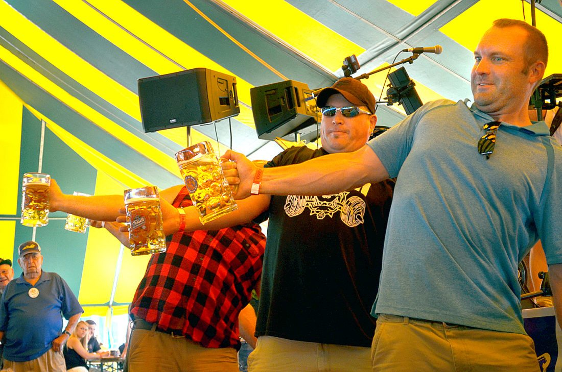 Staff photo by Connor Cummiskey Men followed the ladies in the Stein Holding Contest Saturday at Bavarian Blast. After almost 10 minutes, every competitor was showing strain. For more photos, turn to page 6B, and go to The Journal's CU site, cu.nujournal.com