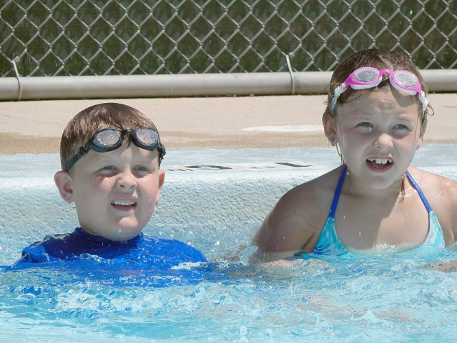The Sellner kids, Ava and Carson, of Sleepy Eye keep cool Monday afternoon at the Washington Park wading pool. Pool admission is free at Lincoln and Washington Parks to children eight years old and under from 12:30 to 6:30 p.m. daily through Aug. 20. Pools are closed if the temperature does not reach 72 degrees.