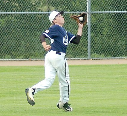 File photo by Steve Muscatello New Ulm VFW Silver's Ben Arnoldt makes a running catch in left field during a recent game at Mueller Park in New Ulm.