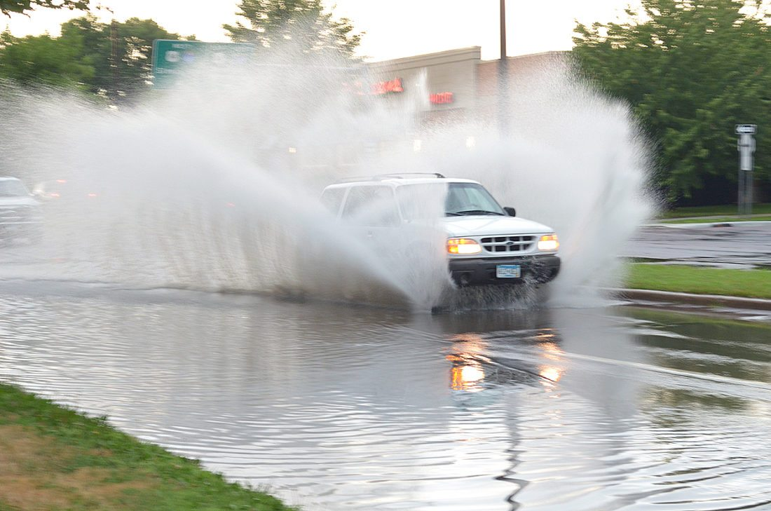 A white SUV plows through a puddle on Broadway Ave. and 6th St. N. that covered virtually the entire southbound lane after a bout of heavy rain Wednesday. A total of .44 inches fell in a matter of minutes, overwhelming the storm sewer drains. The severe thunderstorm spawned a tornado warning about 2:45 p.m. when weather radar spotted a tornado-like rotation. No funnel was seen but high winds caused some damage as the brunt of the storm swept through southern Brown County. The County Sheriff's office reported a semi-truck was overturned by wind at the intersection of County Roads 8 and 18. It was pulling an empty hog trailer. Trees were damaged and downed northwest of Comfrey at the intersection of Co Roads 21 and 3. A power pole was damaged along 320th Avenue in Mulligan Township. Damage was also reported to farm fields around the county.