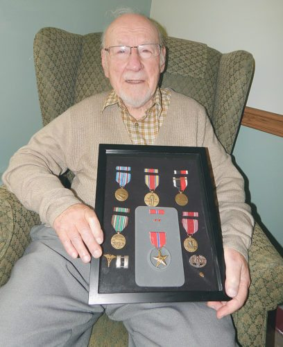 Staff photo by Fritz Busch Winthrop World War II veteran and Good Samaritan Society-Winthrop nursing home resident Dr. Ray Broz will celebrate his 98th birthday July 22. He plans to spend Saturday night having a birthday dinner with his family.
