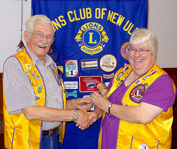 Submitted photo New Ulm Lions Club Past President Wil Burdorf, left, passes the gavel to incoming President Gayle O'Connor.