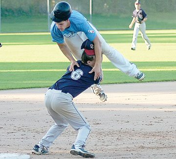 Staff photo by Steve Muscatello Sleepy Eye's Landon Strong tries to avoid the tag by jumping over the Dassel third baseman during VFW playoff action Friday at Johnson Park in New Ulm. For more photos of this event go to cu.nujournal.com