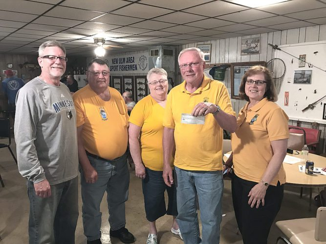 At their June 29th meeting, the New Ulm Area Sport Fishermen presented the Let's Go Fishing Sleepy Eye Chapter with a $1000. donation. NU Area Sport Fishermen Secretary, Ross Nelson. second from right, presented the check to Let's Go Fishing Sleepy Eye Chapter members (from left) Gerry & Linda Schueler, & Dave & Dori Theneman.