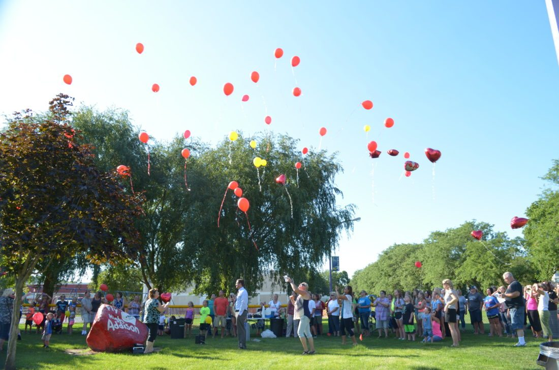 "Staff photo by Connor Cummiskey  Friends, family and classmates of Addison Berdan released red and yellow balloons to the tune of Walt Disney's ""Let it go"" from the animated movie ""Frozen"" in honor of the recently deceased 13-year-old."