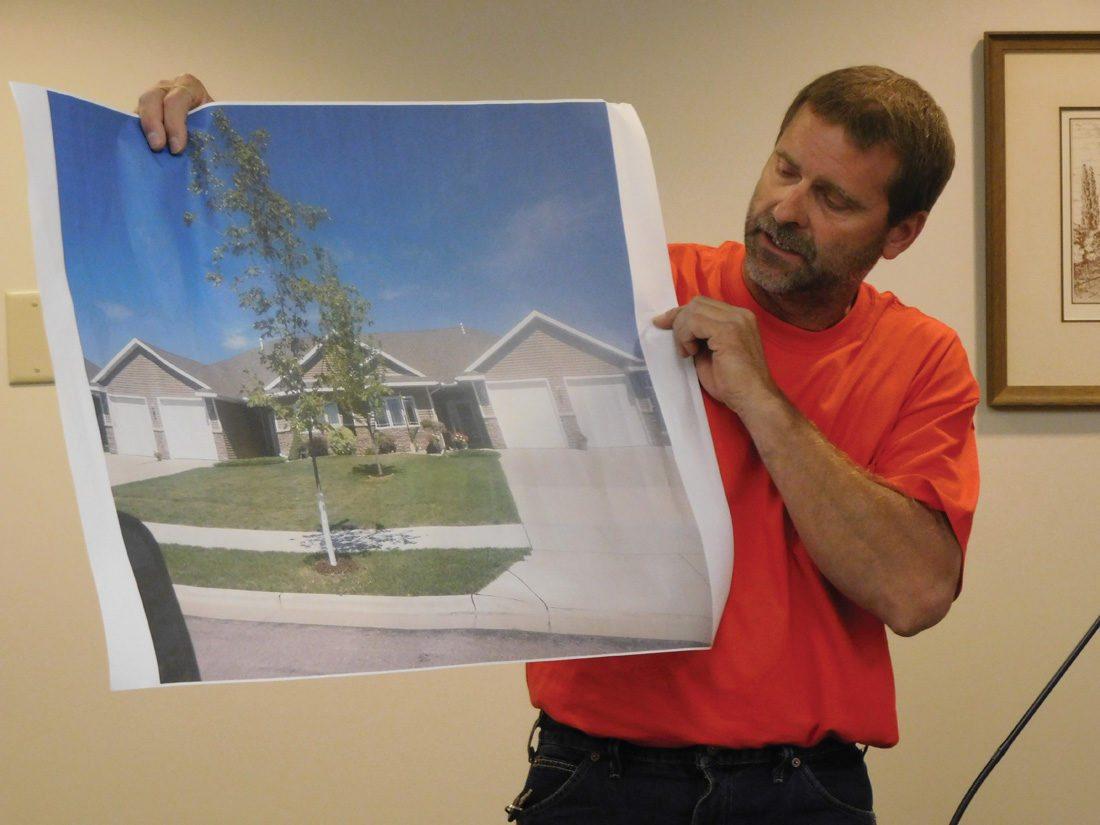Staff photo by Clay Schuldt  Al Poehler, a developer in the Milford Heights Addition, holds a picture of a twin-home design that he plans to implement in New Ulm.