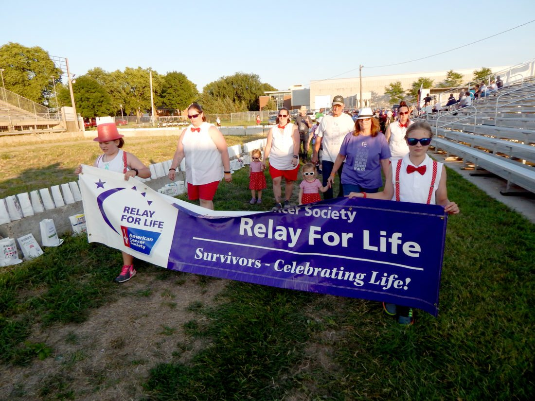 Staff photo by Fritz Busch Cancer survivors march around the grandstand infield at the 22nd Annual Brown County Relay For Life 2017 at the Brown County Fairgrounds Friday. More photos from the event will be published on Sunday.