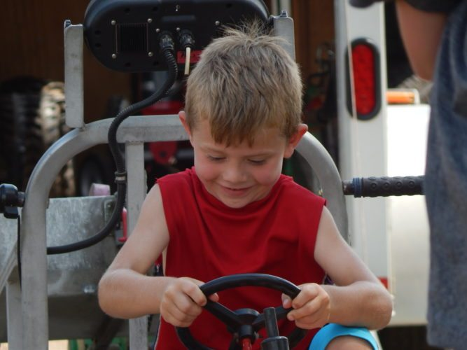 Staff photo by Fritz Busch  Rylen Ahrends, 5, of Marshall participates in the kid's pedal pull at Farmfest at Gilfillan Estates Tuesday. Kid's pedal pulls continue at 1 p.m. Wednesday and Thursday at Farmfest.