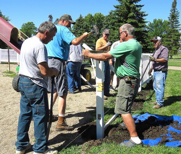 Submitted photo Lafayette Area Lions Club members added a new fence to the kiddie park recently. From left, Steve Sjostrom, Dale Bjorklund, Joe Maidl (back), Mark Dick, Dwight DeBoer (hidden), Dean Koppelman of Rohlfings of Cleveland, and Mark LeGare work on the project. Others helping with the project were Arden DeBoer, Andrew Maidl and Ruth Klossner.