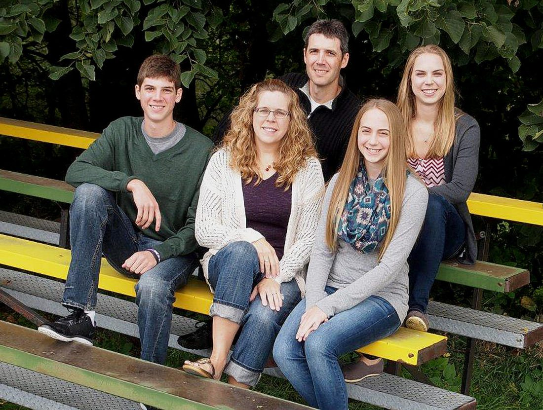 Photo courtesy of Terry Helget Terry Helget poses with his family. Front row from left: son Jay, wife Tammy, daughter Mallory. Back row: Terry, daughter Maddy.