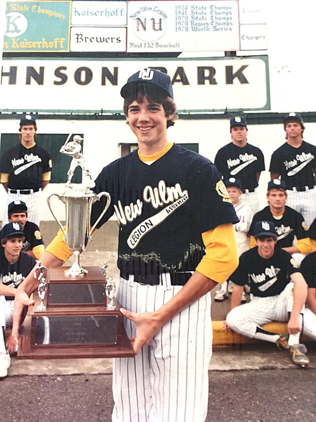 Photo courtesy of Terry Helget Terry Helget poses with a trophy as part of the New Ulm Legion baseball team that qualified for the 1985 American Legion World Series in Kokomo, Indiana.