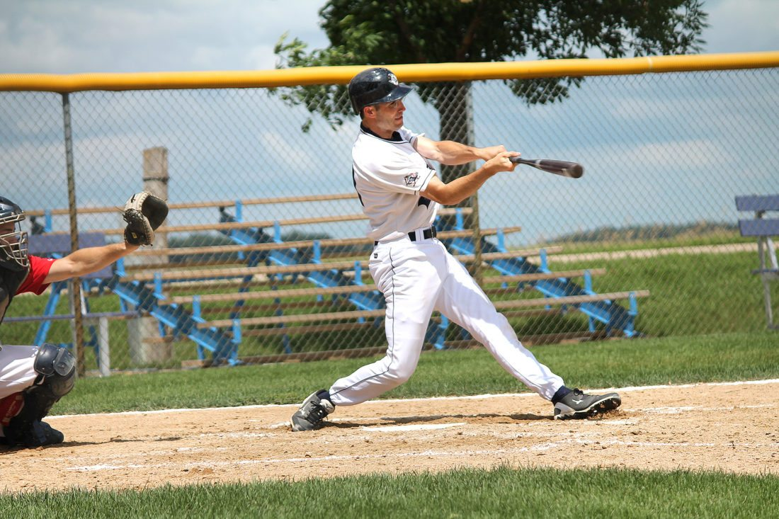Photo courtesy of Terry Helget Terry Helget takes a swing during an amateur baseball game as part of the Essig Bluejays.