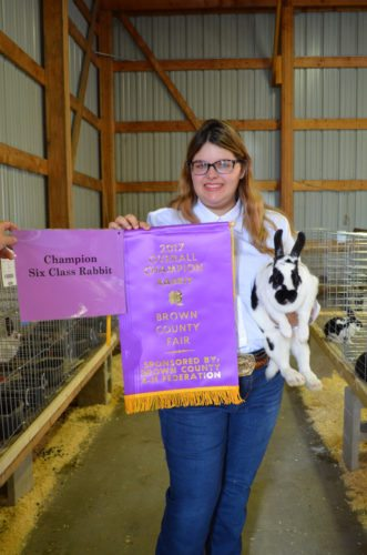 Staff photo by Connor Cummiskey  Kaylyn Severin won champion rabbit Thursday during the 4-H Rabbit Show Thursday at the Brown County Fair.