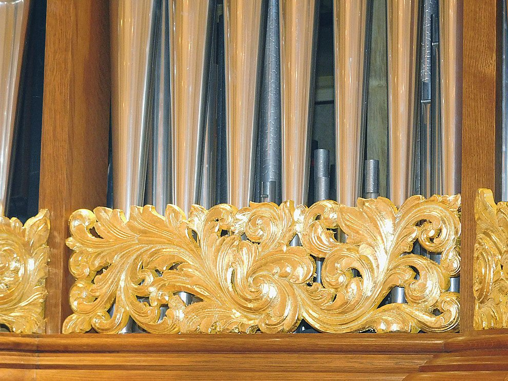Staff photo by Clay Schuldt The new organ features hand carved wood ornamentation that is inlaid in gold. The decorations were designed to match the interior of Cathedral.
