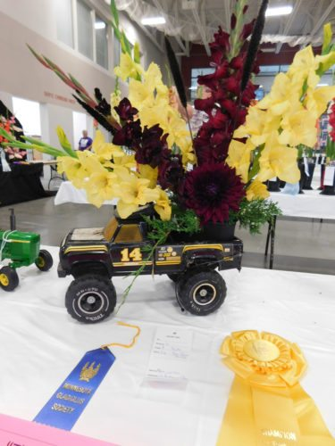 Staff photo by Clay Schuldt   The Gladiolus Society was able to fill an entire table with youth entries. Anyone under the age of 17 could enter the youth division. The youth still needed to follow the county fair theme. Many chose to incorporate toys in demo derby-themed exhibits.