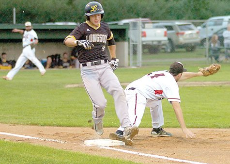 Lamberton's Nick Altermatt beats out the throw to first during a playoff game in Stark.