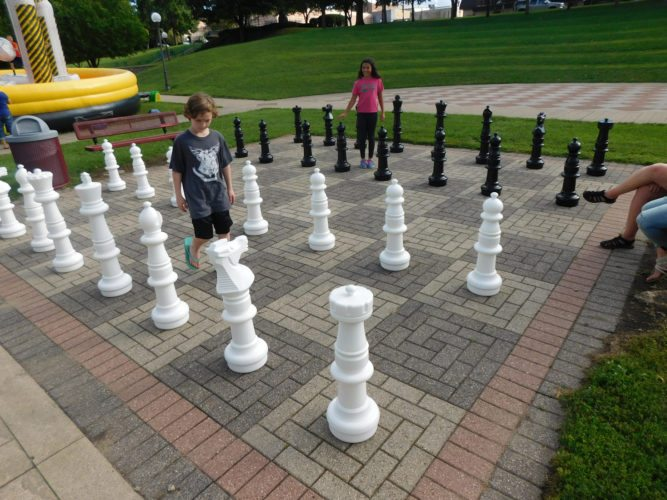 Brennen Benson and Taylor Grant play an epic game of chess during Thursday night's Day of Play. Benson played the white pieces. Grant played the black pieces.